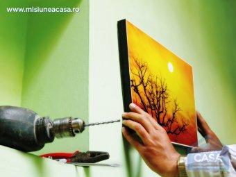 fixarea unui tablou pe perete