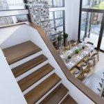 Placarea cu trepte din lemn a scarii interioare din beton